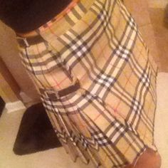 💯% Authentic burberry skirt Authentic wool pleaded with real leather straps burberry skirt, in AMAZING CONDITION, gorgeous on! This skirt is so hot on but I have way to much stuff😫, this would fit sz 2-4 Burberry Skirts