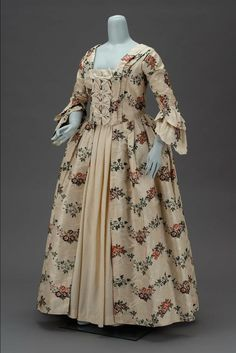 """Robe à l'anglaise: 1763, American (made from English fabric), silk plain weave taffeta patterned with supplementary wefts brocaded with polychrome silks with motifs of ribbons and flowers. """"Worn by Sarah Tyng Smith at her marriage to Richard Codman in Portland, Maine, February 23, 1763."""""""