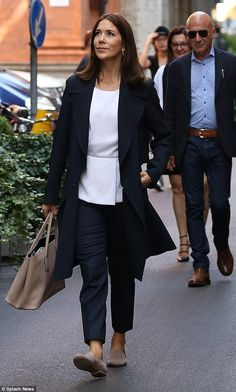 Where's the tiara? Crown Princess Mary stepped out in Milan to go hat shopping...
