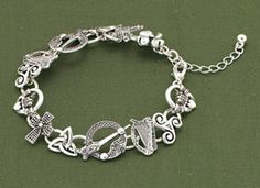 Irish Symbols Bracelet- symbols include claddagh, triple spiral, harp, Tara brooch, Celtic cross, trinity knot, Bridget's cross  a shamrock.