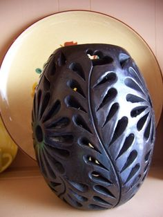 this beautiful black pottery is from mexico  before the 1980s , dona rosa died in 1980  known as oaxaca black ware cut-out pottery  or dona rosa pots  made in mexico  signed on the bottom by dona rosa  approx. 5 in diameter at center  and 6 1/4 tall