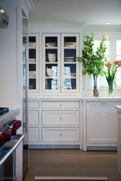 cabinets to the ceiling and down to counters. drawers instead of doors below.