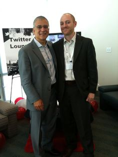 Carlos Dominguez Sr VP, Office of the Chairman and CEO at Cisco Systems and Jon Accarrino, director of social media for Definition6 pose in the Twitter lounge #RaganCisco