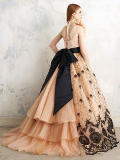 lace in the front and ruffles at the back with a big silky bow
