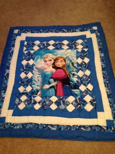Disney Frozen quilt featuring the Ice Princess! Beautiful blue handmade Disney Frozen patchwork quilt with large Anna and Elsa panel.