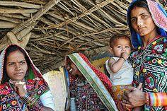 Meghwal Women (Leonid Plotkin) Tags: woman baby india asia child mother tribal tradition tribe ethnic gujarat tradtional kutch janan harijan meghwal megwal katchchh