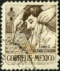 old Mexican postage stamp with a man reading Royalty Free Stock Photo