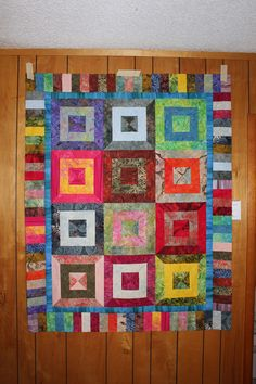 Charm Shack Squared from batik strip roll; shop sample, original pattern.