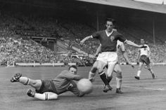 United's Dennis Viollet is beaten to a cross by Bolton goalkeeper Eddie Hopkinson in the FA Cup final on 3rd May 1958.