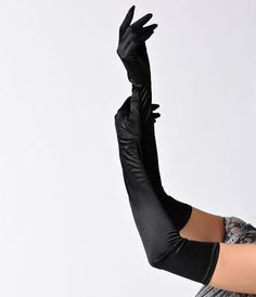 Add a dramatic flair to your next formal outfit by accessorizing with these black satin opera gloves from Unique Vintage. Although theyre much too theatrical for daily wear, these vintage-inspired gloves extend above the elbows to create the perf 1920s Flapper Costume, Beaded Flapper Dress, Flapper Dresses, Flapper Accessories, Vintage Accessories, Fashion Accessories, Long Gloves, Black Gloves, Leather Gloves