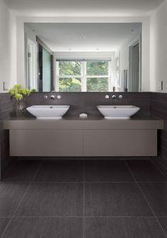 sink walnut floors bathroom interior architecture 24x24 floor tiles, and 2x12 wall tiles@Jenny Enzlin