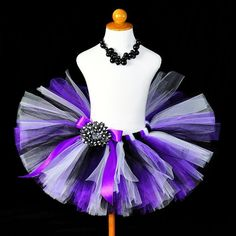 The Purple Pizzazz tutu is made with white, black and purple tulle. This tutu makes a fabulous tutu for a Halloween witch tutu costume, rock star birthday tutu, dance tutu, pageant tutu or for everyday play. Tutu includes satin bow at the waist and optional flower clip and crochet