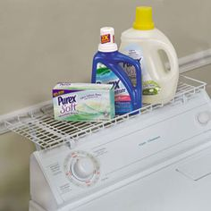 The Over the Washer Storage Shelf creates storage space for your laundry accessories out of thin air with steel construction and white vinyl coating.