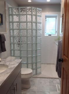 A tub to glass block walk in shower conversion with a curved glass wall | Innovate Building Solutions