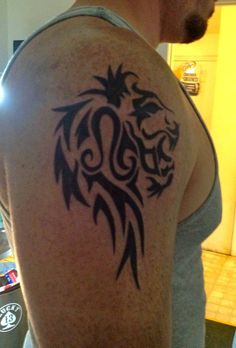 Tribal Leo Zodiac Sign Black Ink Tattoo Design On Right Shoulder - http://tattooideastrend.com/tribal-leo-zodiac-sign-black-ink-tattoo-design-on-right-shoulder/ - #Design, #Shoulder, #Tattoo