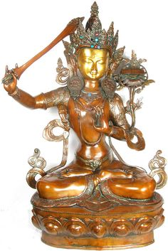 Manjusri, the embodiment of the wisdom of all the Buddhas. His attributes are a book placed on a lotus flower above his left shoulder and the sword of wisdom which cuts the veil of ignorance above his right shoulder. Dje Tsongkhapa is venerated as an emanation of Manjusri.