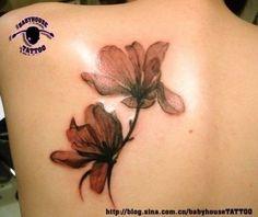 pressed flower tattoo