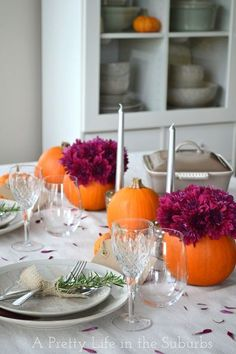 Pumpkins aren't just for carving - use them as vases to create beautiful holiday table settings.