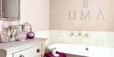 The bathroom is painted in Calamine by Farrow & Ball.