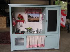 Entertainment center turned kitchen play set