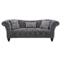 Add stately style to your living room or den with this elegant sofa, showcasing rolled arms, nailhead trim, and a button-tufted seat.  ...
