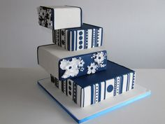 unique design wedding cakes custom design two colors 4 tier with dark blue wedding cake Navy Blue Wedding Cakes, Cool Wedding Cakes, Wedding Cake Toppers, Shaw Commercial Carpet, Cake Decorating Books, Engagement Cakes, Mr And Mrs Wedding, Cake Gallery, Wedding Cake Inspiration