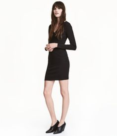 Black. Short, fitted dress in ribbed jersey with a V-neck, attached wrapover section at front, and long sleeves.