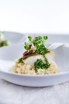 A simple delicious recipe for Seared Black Cod (or halibut, sea bass or scallops) with a lightened-up Meyer Lemon Risotto and Gremolata- a flavorful green herb sauce.   ww.feastingathome.com