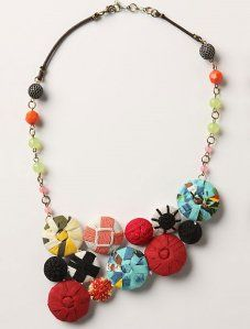 Fabric covered buttons are easy to do.  This necklace is nice inspiration.  Plain buttons can be purchased at the sewing center and covered with your choice of fabrics.