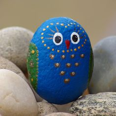 Rock art: Handsome rock owl in blue and green and gold by Livingpebbles on Etsy