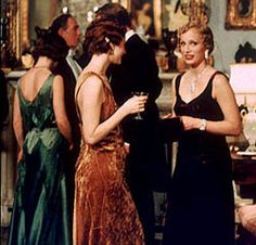 "The infamous green dress from ""Gosford Park"" that I automatically associate with the 1920s-1930s (""such a trying color"")."