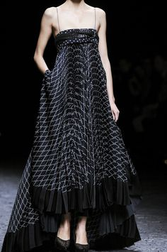 J'ADORE!!!!  It seems like this dress would drown the frame of the model, but the small pattern play, perfectly placed pleats causing the right amount of poof, AND pockets!!!  Haider Ackermann - SS 2013