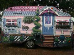 Cute! Look at the amazing Victorian paint job on this camper.