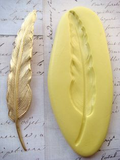 FEATHER (large) - Flexible Silicone Mold - Push Mold, Jewelry Mold, Polymer Clay Mold, Resin Mold, Craft Mold, Food Mold, PMC Mold. $8,99, via Etsy.