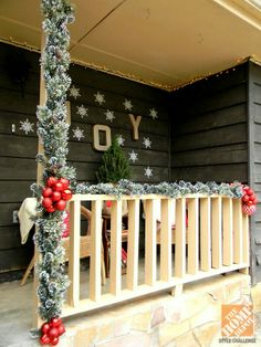 This is how my porch is except more two more pillars to wrap garland around! Yay!