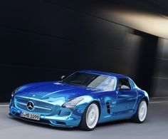 Mercedes-Benz SLS AMG Coupe Electric Drive  A 740 horsepower Benz coupe painted a chrome-Bieber blue is sure to turn some heads as it speeds past at 155 MPH. But one key detail that will escape detection at that speed is the fact that this thing is electric. True. The SLS AMG Coupe Electric Drive, due out next summer, marks the end of the electric-equals-boring era.