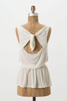 the back detailing. ++ pintuck peplum blouse ++ anthropologie