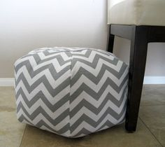 ottoman/pouf... this is a piece that can be used to prop up your feet and relax, or you can put a laptop on it and use it for a task that you can preform from the sofa. or it can also be used for added seating