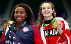 Gold medallists Simone Manuel of the United States (left) and Penny Oleksiak of Canada celebrate during the medal ceremony for the Women's freestyle final at the Rio 2016 Olympic Games. © Clive Rose/Getty ImagesHow Canada's athletes fared Thursday in Rio Simone Manuel, Rio Olympics 2016, Summer Olympics, Olympic Sports, Olympic Games, Olympic Records, Heptathlon, Coaching, Olympic Gold Medals