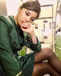 """I think - "" the Eva Air stewardess said slowly and thoughtfully ""that you should surrender to me now, before you get yourself into any more trouble."""