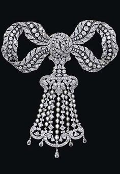 A RARE BELLE EPOQUE DIAMOND AND PEARL BROOCH  Designed as an openwork old European-cut diamond ribbon bow, suspending an alternating pearl and old European-cut diamond fringe, accented by old European-cut diamond scrolls, terminating with five pear-shaped diamonds, mounted in platinum, (fringe detachable), circa 1910