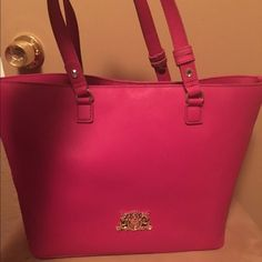 FLASH SALE‼️ 1 hr. Pink juicy couture tote Absolutely love this bag, but I bought myself a pink Kate spade similar to this. Worn probably about 5-6 times. It's a big sized tote and has a lot of room to hold whatever you please. On each strap there is a little rhinestone-as you can see in the pictures. Juicy Couture Bags Totes