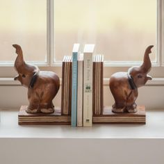 This pair of Wooden Elephant Bookends are carved from Monkey Pod wood by Thai artisans. A functional product, making a practical feature on any shelf. Charmed Characters, Monkey Pod Wood, Wooden Elephant, Bookends, Artisan, Carving, Shelf, Crafts, Animals