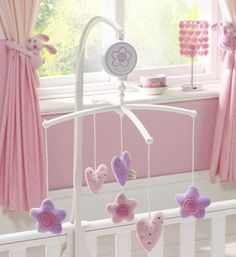 Image from http://www.comparestoreprices.co.uk/images/lo/lollipop-lane-rosie-posy--musical-cot-mobile.jpg.