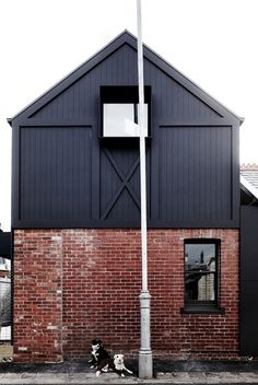 BARN HOUSE BY STUDIO ARRC - black and brick outside - adorable dogs
