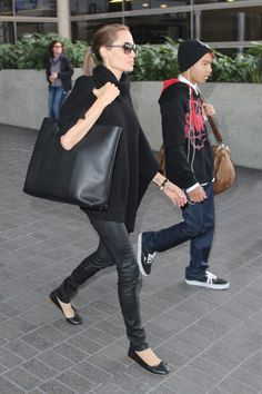 Angelina Jolie pulls together an all black look with an Everlane Petra tote.