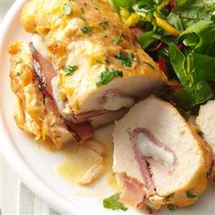 Stuffed Chicken Rolls Recipe -The wonderful aroma of this moist, delicious chicken cooking sparks our appetites. The ham and cheese rolled inside is a tasty surprise. When I prepared this impressive main dish for a church luncheon, I received lots of compliments. The rolls are especially nice served over rice or pasta. -Jean Sherwood, Kenneth City, Florida
