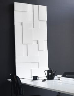 Maak van verschillende groottes mdf-platen een stijlvol vlakkenkunstwerk.