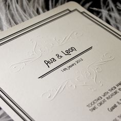 art deco wedding invitation with embossed detail