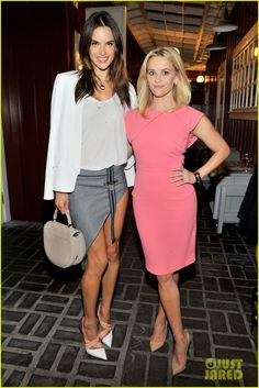 Alessandra Ambrosio & Reese Witherspoon in a Roland Mouret dress, Christian Loubotin heels, and vintage jewels.